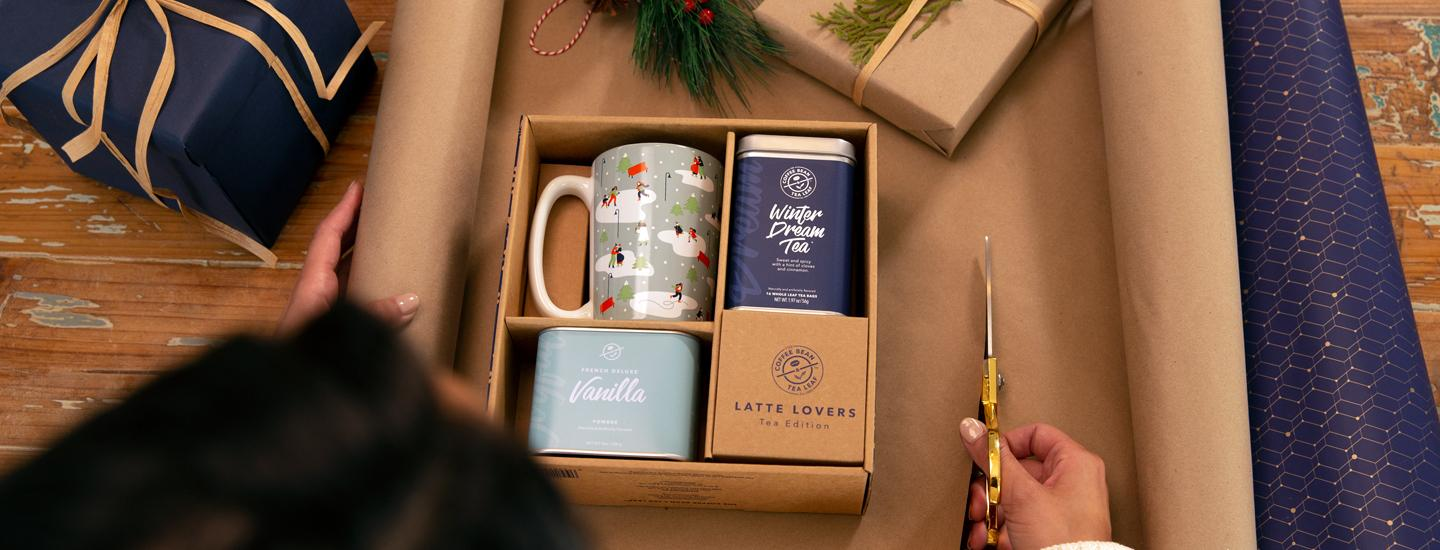 winter dream tea gift set includes winter dream tea, vanilla powder, and a festive blue holiday mug.