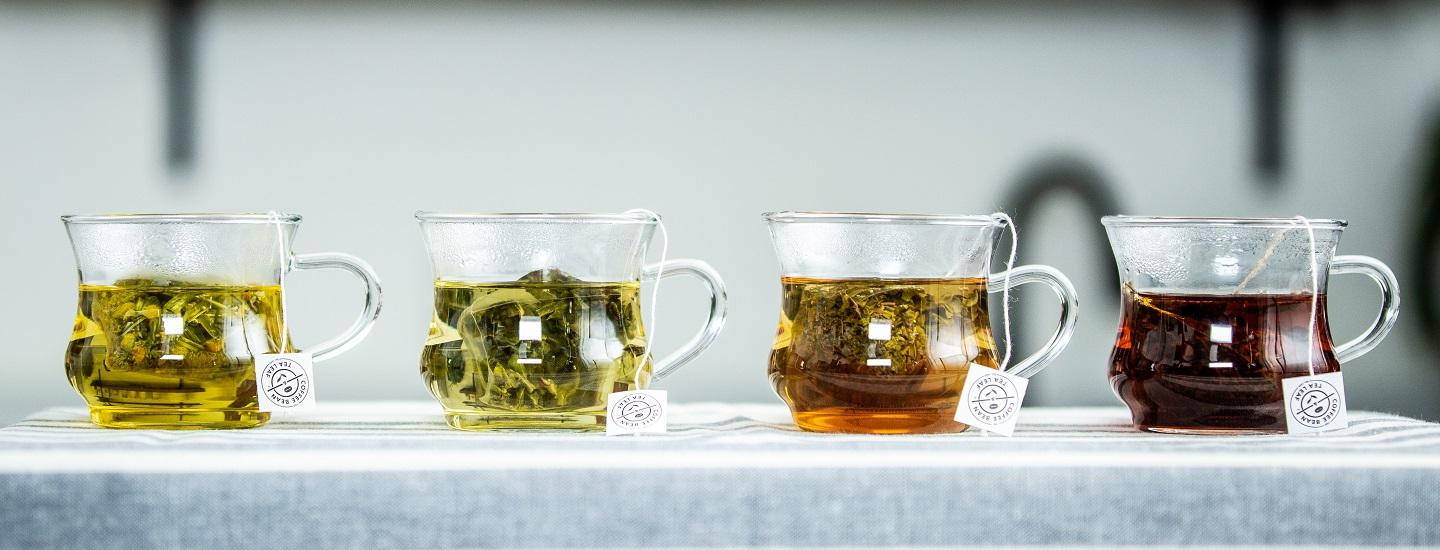 three different types and colors of tea