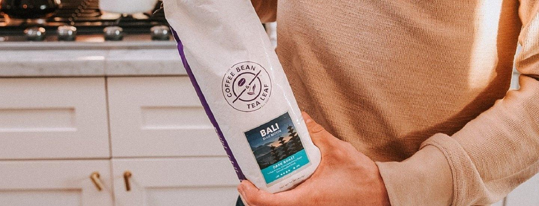 man holding bali coffee bag