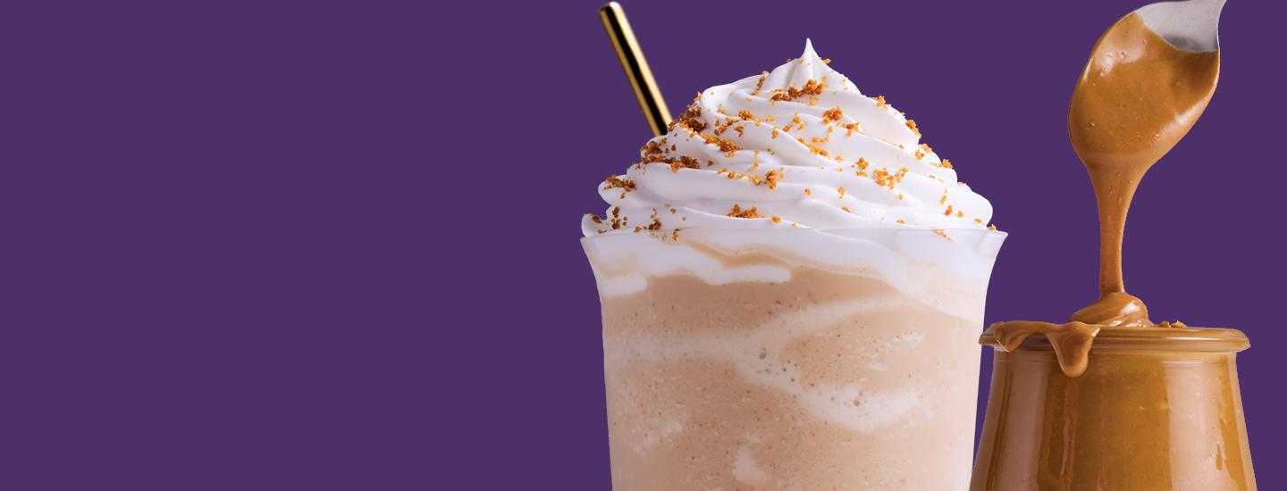 Cookie Butter Ice Blended drink with Cookie Butter dripping from a spoon