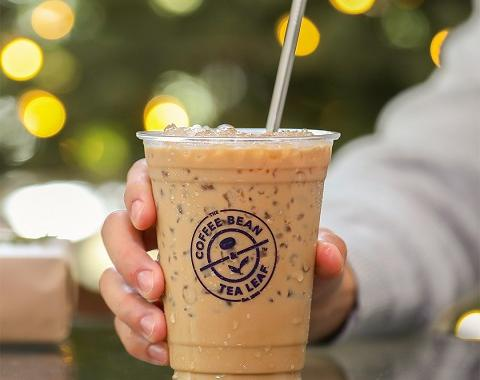 person holding an iced latte
