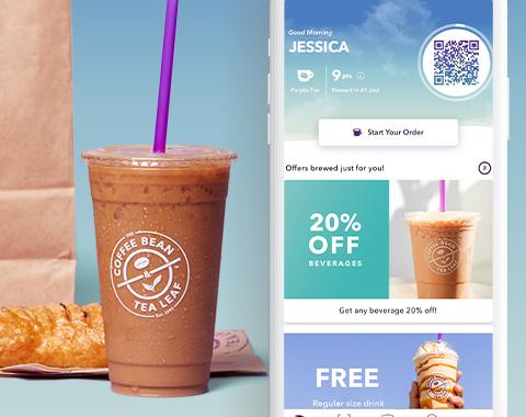 Iced Latte with a pastry and a phone featuring The Coffee Bean Rewards app