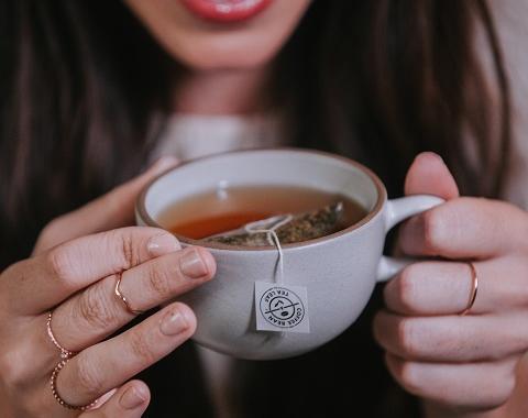 woman tasting tea